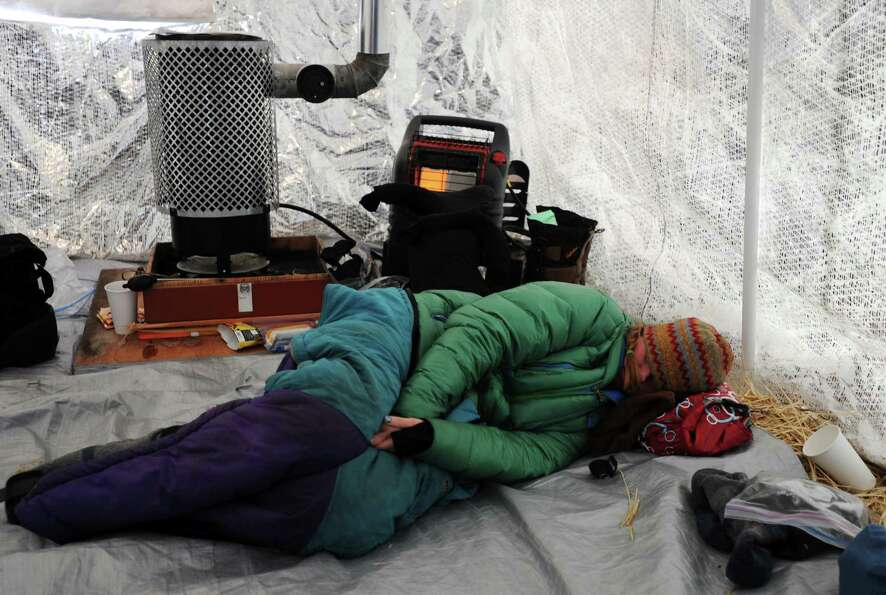 Angie Taggart rests in a musher tent at the Finger Lake checkpoint in Alaska during the Iditarod Tra