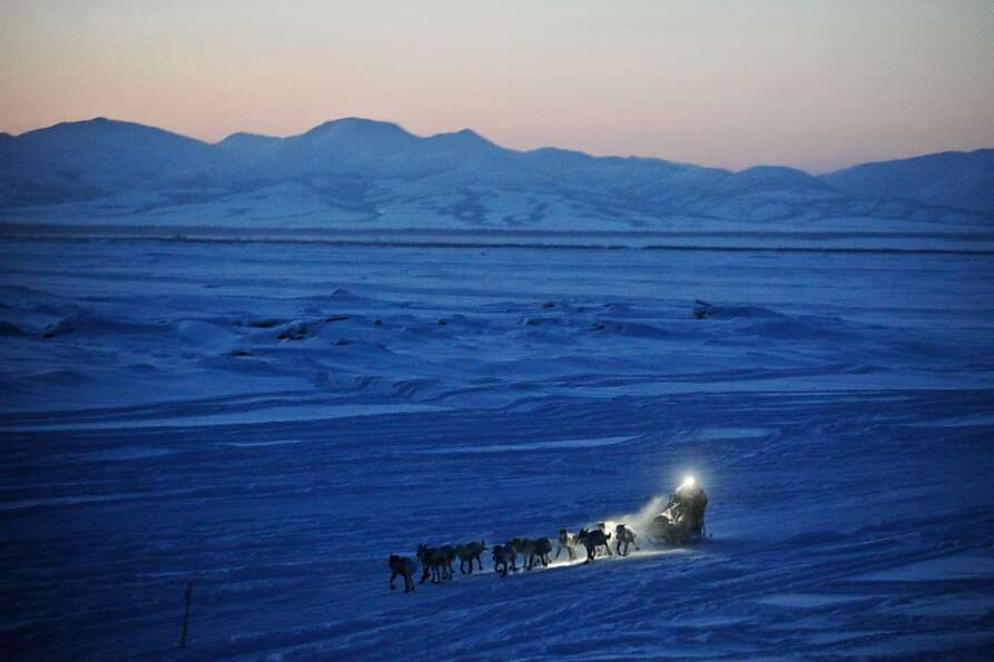 FILE - Dallas Seavey pulls in to the checkpoint in Unalakleet, Alaska, during the Iditarod Trail Sle