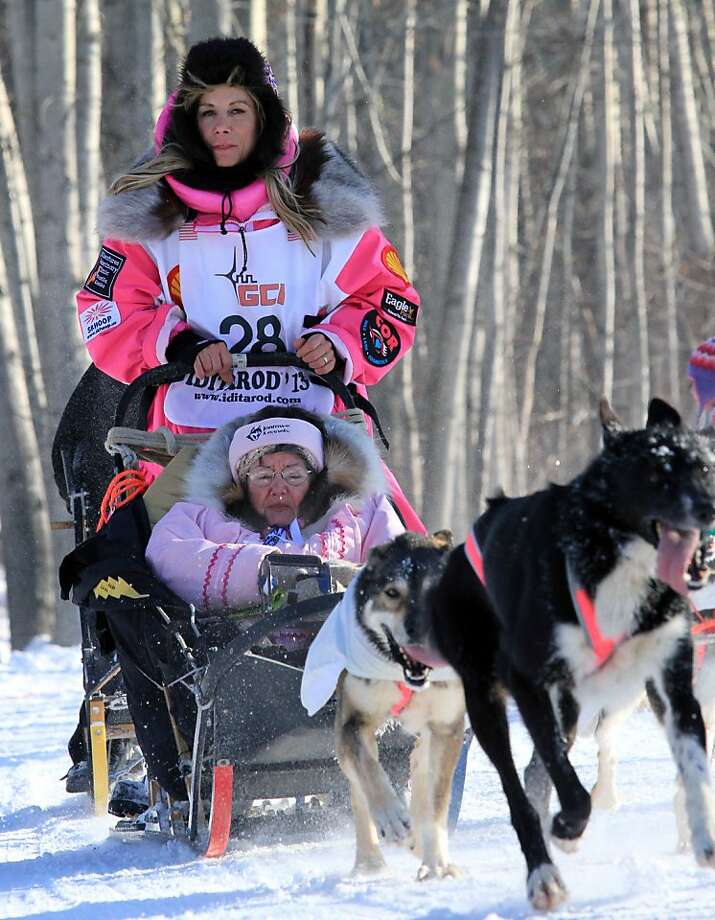 DeeDee Jonrowe drives her team during the ceremonial start of the Iditarod Trail Sled Dog Race Saturday, March 2, 2013, in Anchorage, Alaska. The competitive portion of the 1,000-mile race is scheduled to begin Sunday in Willow, Alaska. (AP Photo/Dan Joling) Photo: Dan Joling, Associated Press