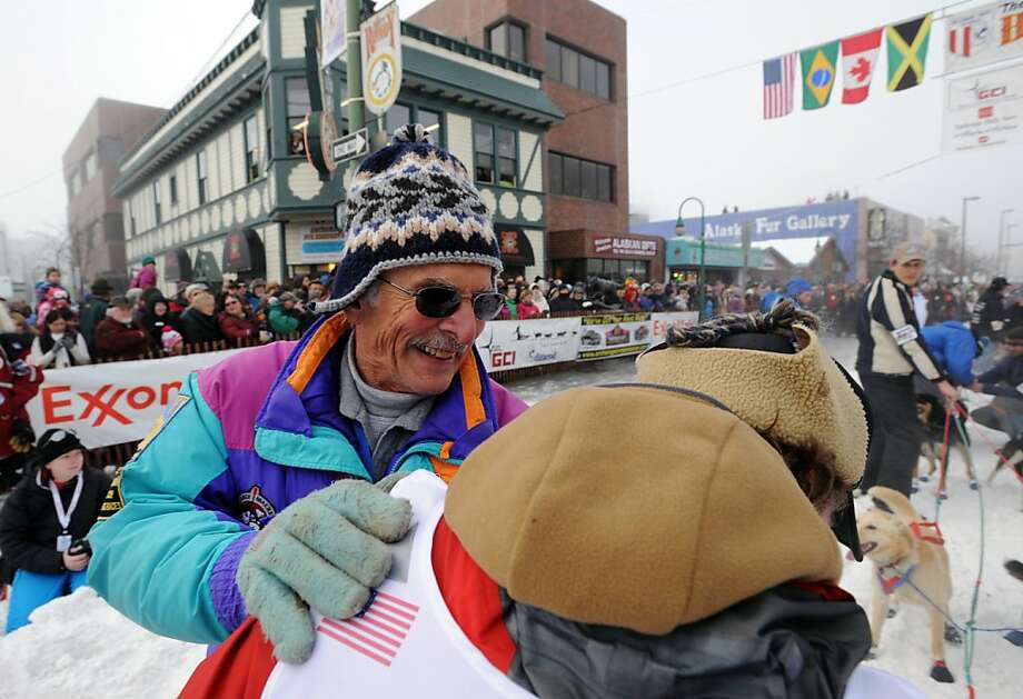Dick Mackey, left, the1978 Iditarod champion, speaks to his son Jason Mackey as he prepares to leave the start line during the ceremonial start of the Iditarod Trail Sled Dog Race on Saturday, March 2, 2013, in Anchorage, Alaska. The competitive portion of the 1,000-mile race is scheduled to begin Sunday in Willow, Alaska. (AP Photo/Anchorage Daily News, Bill Roth) Photo: Bill Roth, Associated Press
