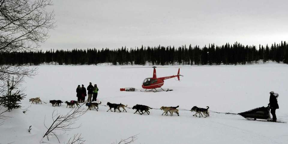 Jessie Royer leaves the Finger Lake checkpoint in Alaska during the Iditarod Trail Sled Dog Race on