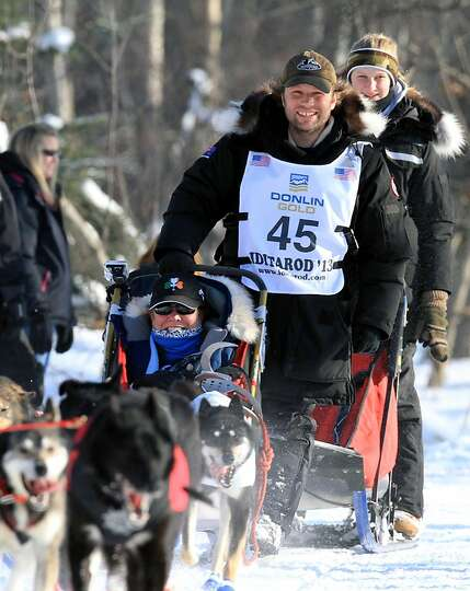Curt Perano of New Zealand drives his team during the ceremonial start of the Iditarod Trail Sled Do