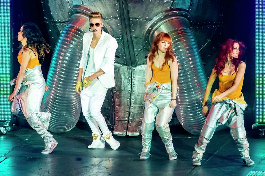 Justin Bieber performs on stage in concert on the opening London night of the Believe World Tour at O2 Arena on March 4, 2013 in London, England. Photo: Neil Lupin, Redferns Via Getty Images / 2013 Neil Lupin