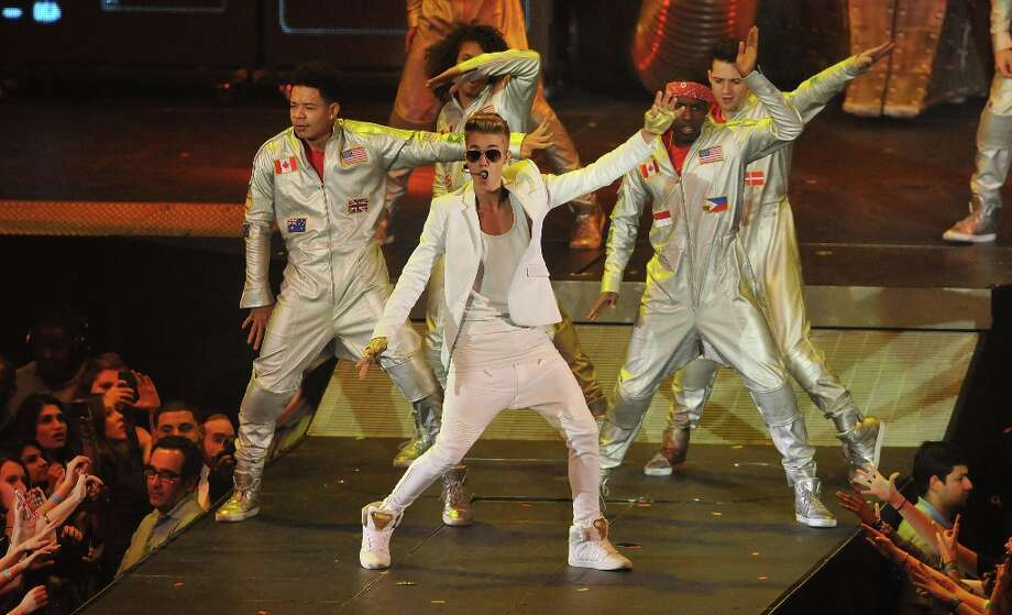 Justin Bieber performs live on stage at 02 Arena on March 4, 2013 in London, England. Photo: Jim Dyson, Getty Images / 2013 Getty Images