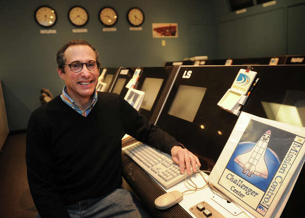Alan Winick, director of education at the Discovery Museum in Bridgeport, in the museum's Challenger Center, which will be completely updated as part of NASA's CubeSat Launch Initiative program. A small satellite, designed by the museum to study space debris, will be launched as part of the program. Photo: Brian A. Pounds / Connecticut Post