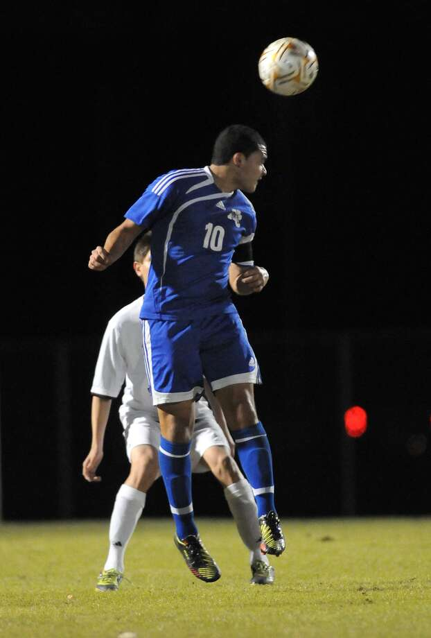 New Caney senior Brian Lopez heads the ball against Summer Creek. Photo: Jerry Baker, Freelance
