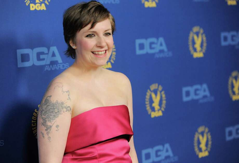 "FILE - This Feb. 2, 2013 file photo shows Lena Dunham at the 65th Annual Directors Guild of America Awards at the Ray Dolby Ballroom in Los Angeles. Dunham is urging her fellow ""Obies"" to stick together as her alma mater in Ohio wrestles with reports of racism. The creator and star of HBO's ""Girls"" wrote on her Twitter account Monday, March 4, after learning about racist graffiti at famously liberal Oberlin College. (Photo by Chris Pizzello/Invision/AP, file) Photo: Chris Pizzello"