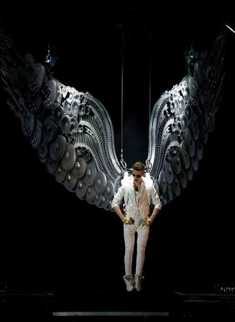 Canadian singer Justin Bieber performs at the o2 Arena in east London, Monday, March 4, 2013. (Photo by Joel Ryan/Invision/AP) Photo: Joel Ryan