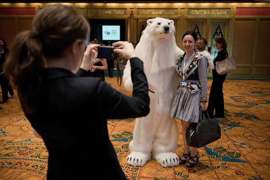 OK, big grin and BEAR it! (Sorry):A guest has her picture taken with a representative of the Convention on International Trade in Endangered Species in Bangkok. Global conservationists converged on Bangkok for the endangered-species talks, with host Thailand on the hot seat over the rampant smuggling of ivory through its territory. Photo: Nicolas Asfouri, AFP/Getty Images
