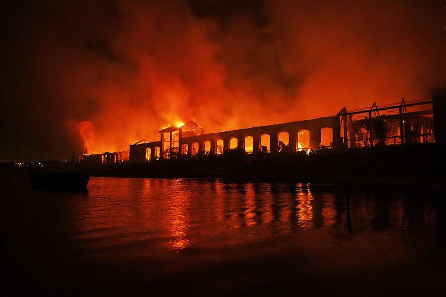 Fire rages through Naples' museum park in the Bagnoli area of the Italian city. Four buildings were damaged by the flames. Photo: Controluce, AFP/Getty Images