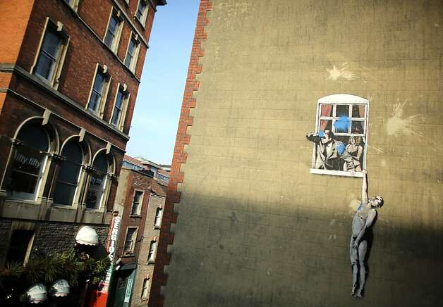 Banksy's endangered art: The Twentieth Century Society has launched a campaign to try to save some of the UK's best known postwar murals, such as this one by street artist Banksy on the side of a building in Bristol, England. The artwork has been defaced by blue paint bombs. Photo: Matt Cardy, Getty Images