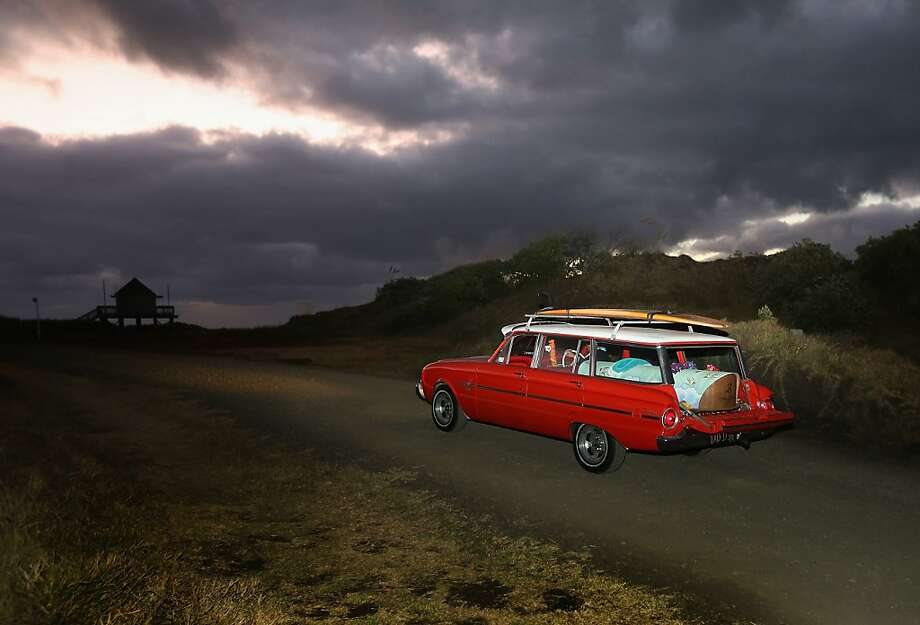 Shark victim: A vintage station wagon in Auckland, New Zealand, carries the body of surfer Adam Strange, who was killed by a shark between Muriwai and Maori Bay a week ago. Photo: Sandra Mu, Getty Images