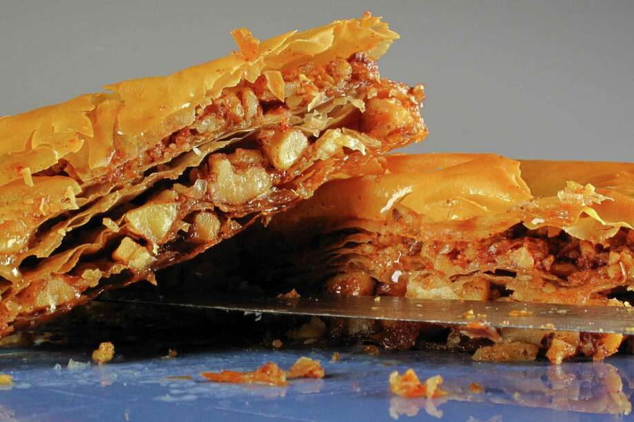 Traditional baklava (above) uses phyllo dough but there is an easier, though less authentic, option. Photo: Michael Paulsen, Houston Chronicle / © 2011 Houston Chronicle