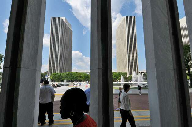 Pedestrians walk on the Empire State Plaza on Tuesday Aug. 2, 2011 in Albany, NY.  (Philip Kamrass / Times Union) Photo: Philip Kamrass, Albany Times Union / 00014126A