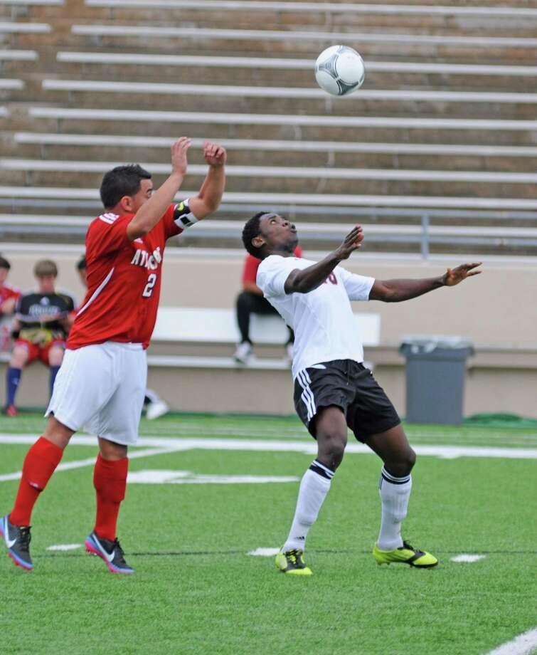 Langham Creek senior Samuel Omondi and the Lobos have clinched a 2013 District 17-5A boys soccer playoff berth. Photo: L. Scott Hainline / Freelance