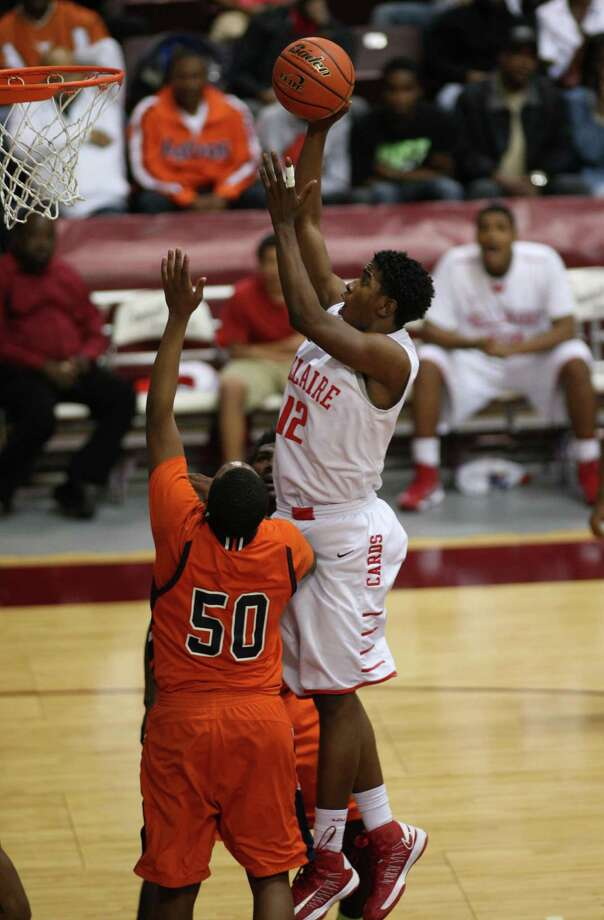 Bellaire's Christian James (right) shoots over Bush's Ladarius Johnson during the second half of a 5A Region III high school playoff basketball game, Friday, March 1, 2013 at the Campbell Center in Houston, TX. (Photo: Eric Christian Smith/For the Houston Chronicle) Photo: Eric Christian Smith, Freelance