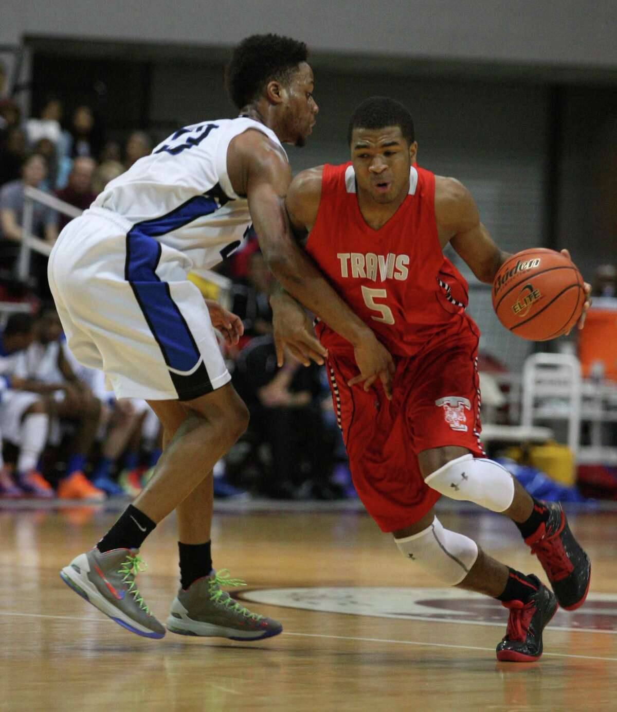 Travis' Andrew Harrison and the Tigers will open their push for a state championship against Richardson Berkner in Austin Friday night.