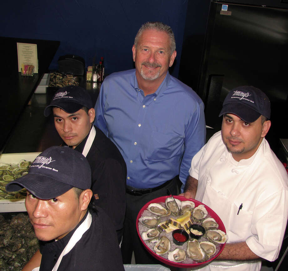 Owner and executive chef Tommy Tollett keeps employees busy shucking oysters. With Tollett, from left, are shuckers Angel Guox and Edwin Capriel and chef Manuel Viveros. Owner and executive chef Tommy Tollett keeps employees busy shucking oysters. With Tollett, from left, are shuckers Angel Guox and Edwin Capriel and chef Manuel Viveros.