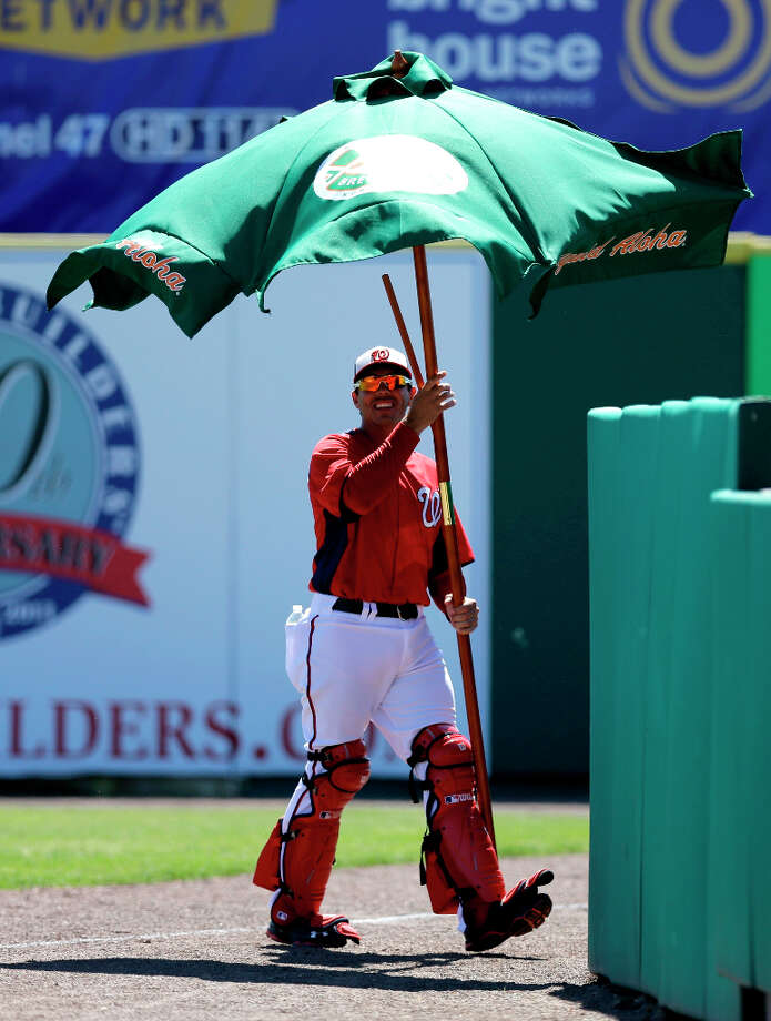 Action briefly stopped during the second inning when an umbrella landed on the field. Photo: David J. Phillip