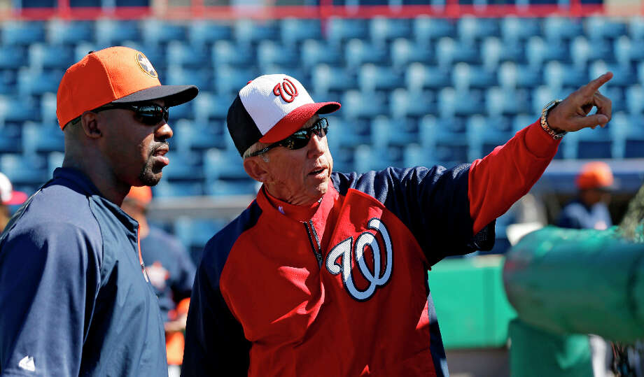 Nationals manager Davey Johnson converses with Astros manager Bo Porter. Photo: David J. Phillip