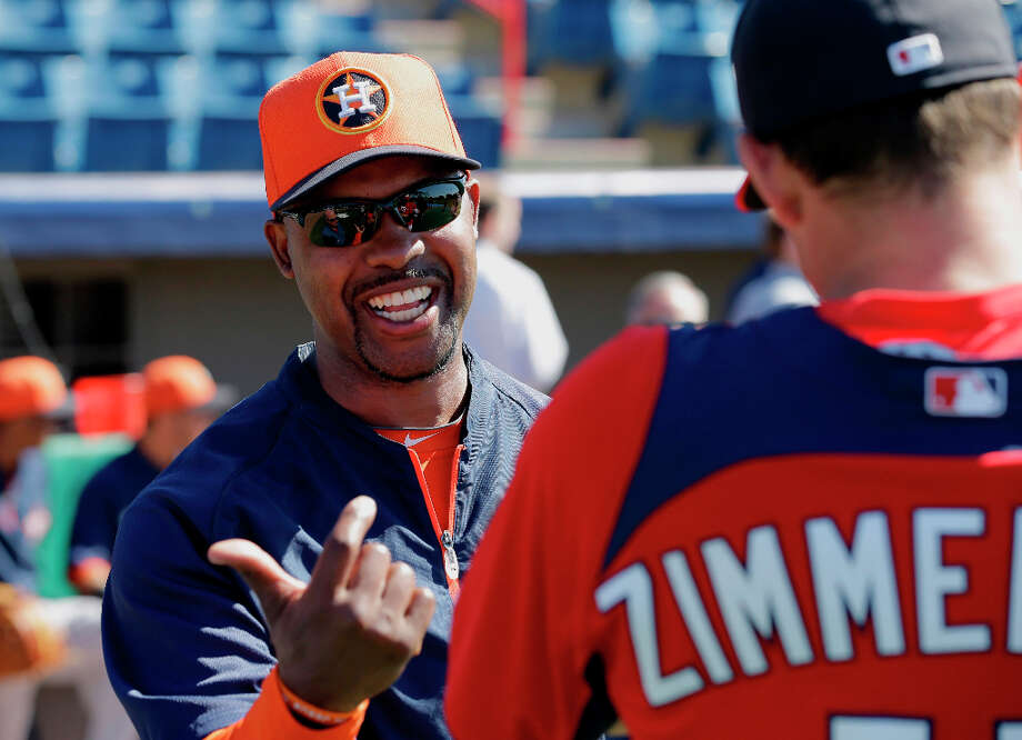 Astros manager Bo Porter happily greets Ryan Zimmerman of the Nationals. Photo: David J. Phillip