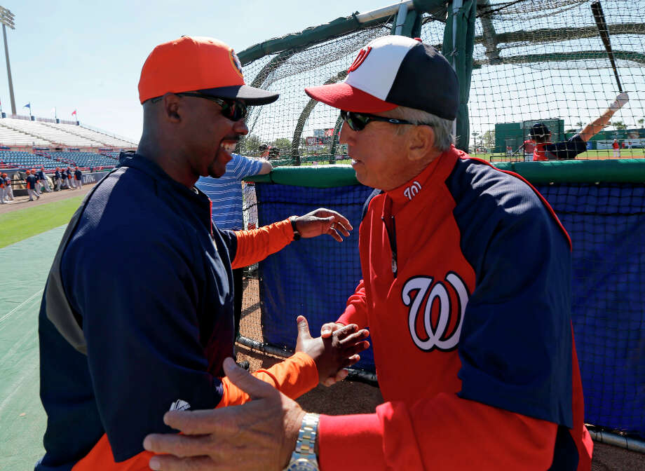Astros manager Bo Porter greets his former boss, Nationals manager Davey Johnson. Photo: David J. Phillip