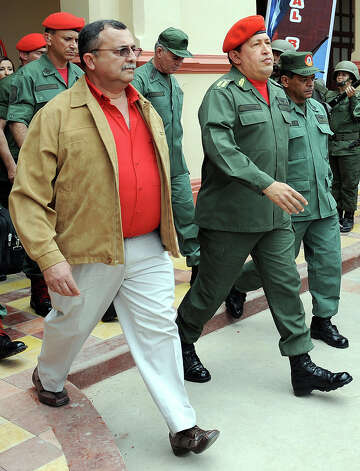 Venezuelan President, Hugo Chavez, walks alongside Vice-President and Minister of Defense, Ramon Carrizalez, and members of the military during an act commemorating the failed coup against Chavez in April 2002 in Caracas on April 13, 2009. Photo: JUAN BARRETO, AFP/Getty Images / 2009 AFP