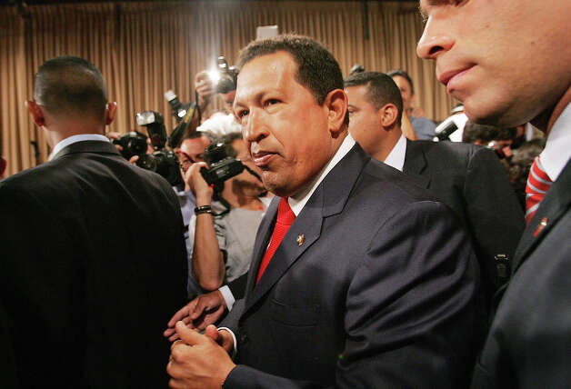 President Hugo Chavez enters a press conference in Miraflores Palace November 30, 2006 in Caracas, Venezuela. Photo: Mario Tama, Getty Images / 2006 Getty Images