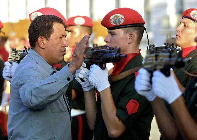 Venezuelan President Hugo Chavez  reviews the troops in Caracas, Venezuela 14 May 2002. Photo: PRESIDENCIA-MIRAFLORES, AFP/Getty Images / AFP