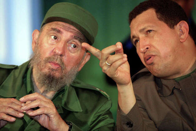 Fidel Castro confers with Venezuelan President Hugo Chavez 11 August 2001 in Bolivar City.  Castro is visiting Venezuela to strengthen ties with Chavez, who has shown a keen interest in taking lessons from the Cuban president on introducing sweeping social change. Castro, who will turn 75 in two days after 42 years in power, arrived at Maiquetia airport outside Caracas on his sixth trip to Venezuela but his third since the charismatic Chavez, 47, took the president's post in February 1999. Photo: ANDREW ALVAREZ, AFP/Getty Images / AFP