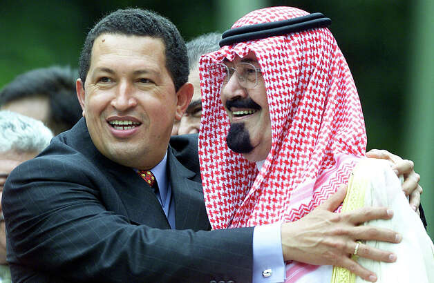Venezuelan President Hugo Chavez hugs Saudi Arabian Crown Prince Abdullah Ibn Abdul Aziz Al-Saud during the official photo session at the end of the OPEC II Summit of oil producing countries in Caracaas 28 September, 2000. Photo: OMAR TORRES, AFP/Getty Images / AFP
