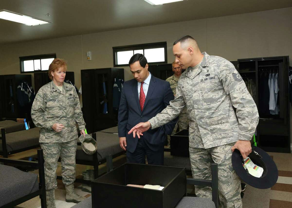 U.S. Rep. Joaquin Castro, center - flanked by Col. Deborah Liddick, commander of the 737th Training Group, left, and Military Training Instructor Tech. Sgt. Pedro Peña, right - was shown the types of attention to detail expected of the Air Force basic trainees.