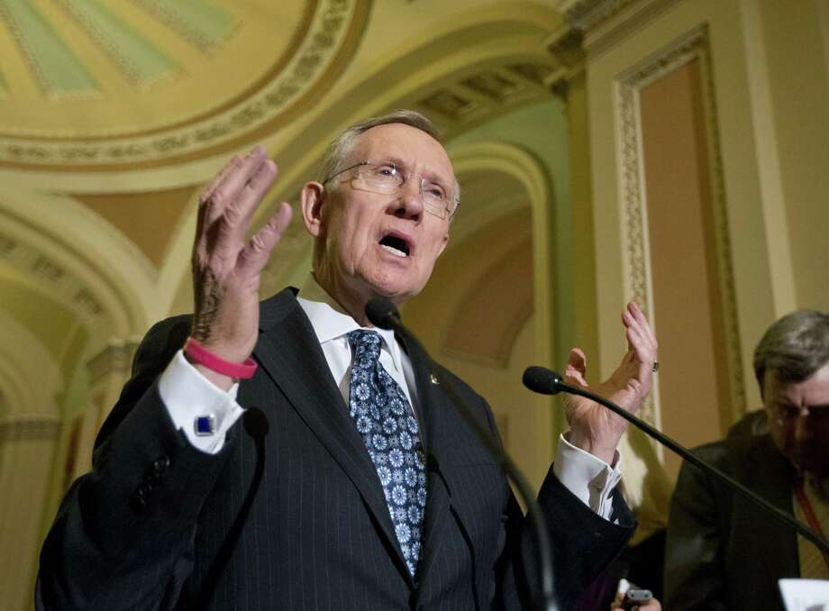 Senate Majority Leader Harry Reid, D-Nev., answers questions on the sequester late last month. Readers share their questions and opinions on the proposed spending cuts. Photo: Associated Press