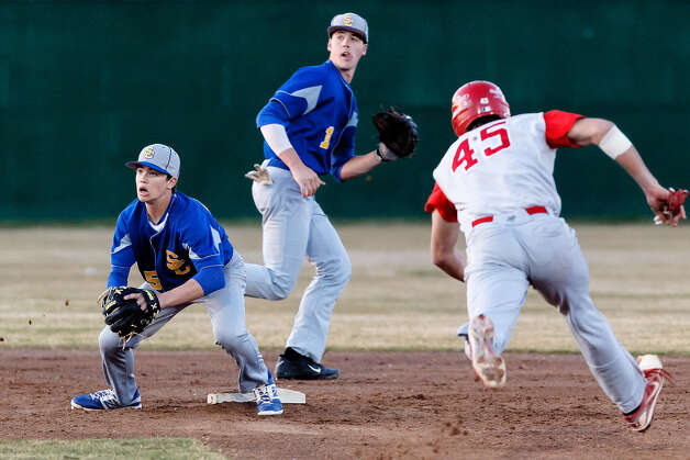 Clemens' Ryan Kinkade (left) waits on the ball, backed up by Tyler Giovanoni, as Judson's Michael Serry races to second during the third inning of their game in the Judson Invitational Tournament Friday. Clemens beat the Rockets, 7-3. Photo: Marvin Pfeiffer / NE Herald