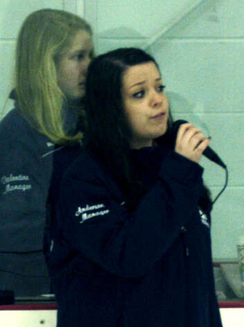 Spartan manager Emily Anderson performs the Star Spangled Banner as fellow manager Kimberly Valentine stands alongside before Shepaug Valley High School co-op ice hockey's match vs. Sheehan Feb. 24, 2013 at The Gunnery rink in Washington Photo: Norm Cummings