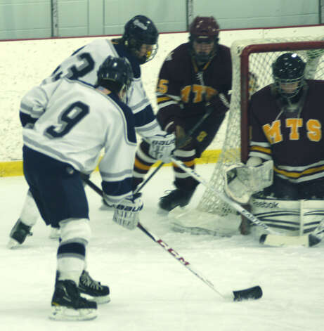 The Spartans' Mike Galinksi (9) and Andrew Loya (23) offer a stern test to the opponents' defense during Shepaug Valley High School co-op ice hockey's match vs. Sheehan Feb. 24, 2013 at The Gunnery rink in Washington Photo: Norm Cummings
