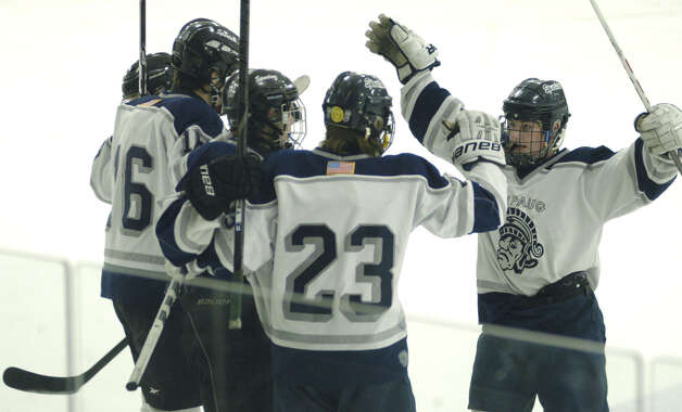 The Spartans celebrate a goal during Shepaug Valley High School co-op ice hockey's match vs. Sheehan Feb. 24, 2013 at The Gunnery rink in Washington Photo: Norm Cummings
