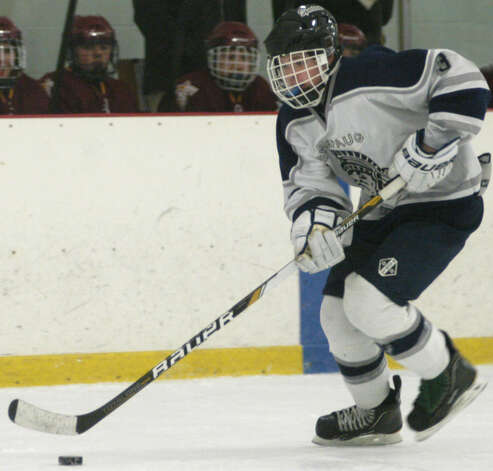 Christian Stuart of the Spartans maintains control of the puck as he weaves through the rival defense during Shepaug Valley High School co-op ice hockey's match vs. Sheehan Feb. 24, 2013 at The Gunnery rink in Washington Photo: Norm Cummings