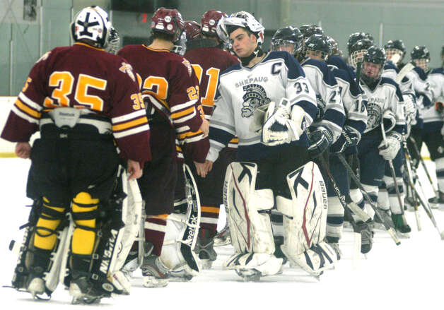 Spartan goaltender Anthony Graziani leads his teammates in the time-honored exchange of respect following Shepaug Valley High School co-op ice hockey's match vs. Sheehan Feb. 24, 2013 at The Gunnery rink in Washington Photo: Norm Cummings