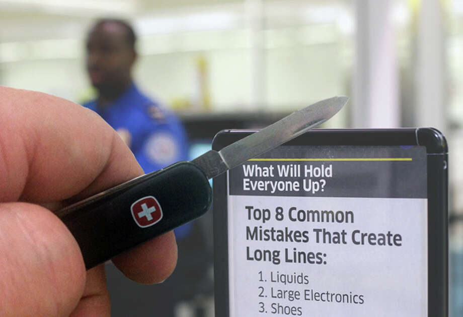 Small Swiss Army knives such as this one will be again allowed on U.S. flights. But you probably shouldn't approach the security agent with the blade open. Photo: Photo Illustration, AP/Chronicle