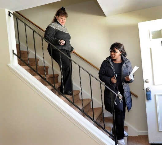 Carolyn Ridenour, 47, left, of Prudential Connecticut Realty, shows Ranisha Green, 25, of Danbury, an apartment for rent at Racing Brook Meadow 1 in Danbury, Conn. Tuesday, March 5, 2013 Photo: Carol Kaliff / The News-Times