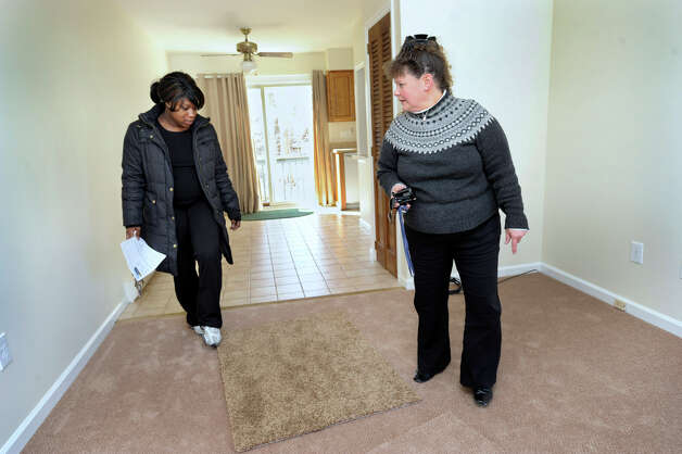 Ranisha Green, 25, left of Danbury, and Realtor Carolyn Ridenour, 47, look at the living room of an apartment in Danbury, Conn., that Green could possibly rent, Tuesday, March 5, 2013. Photo: Carol Kaliff / The News-Times