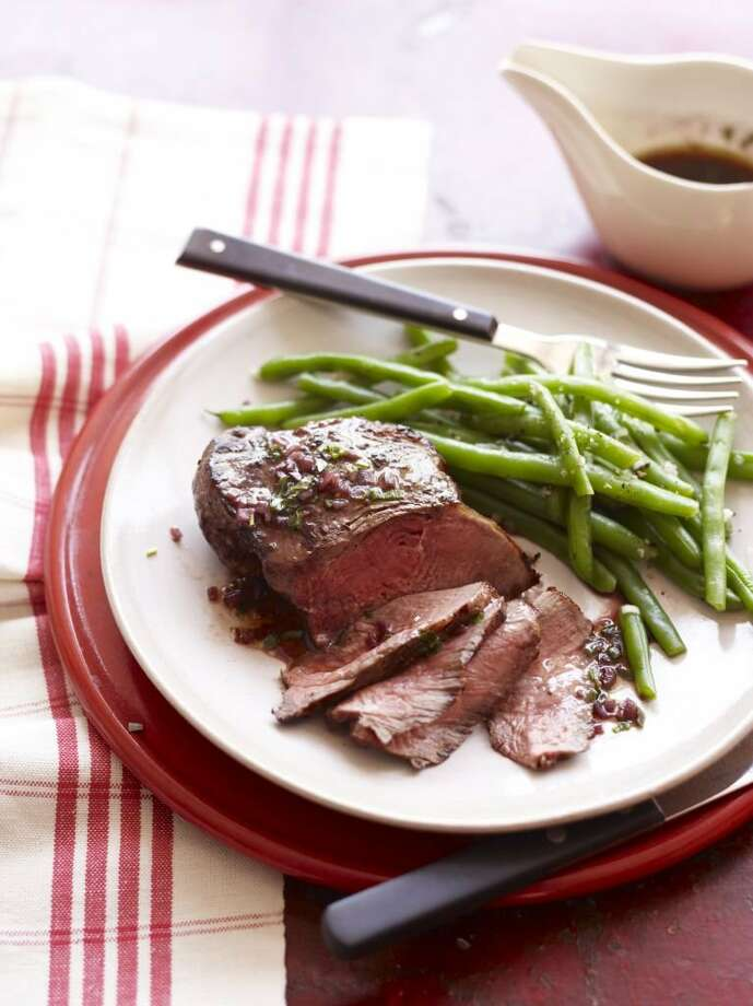 Good Housekeeping recipe for Red Wine Steaks with Green Beans. Photo: Con Poulos