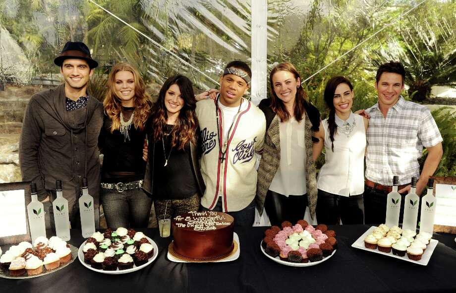 (L-R) Actors Michael Steger, AnnaLynne McCord, Shenae Grimes, Tristan Wilds, Jessica Stroup, Jessica Lowndes and Matt Lanter pose at the CW Network's 90210 Season 5 Wrap Party on March 3, 2013 in Los Angeles, California. Photo: Kevin Winter, Getty Images / 2013 Getty Images