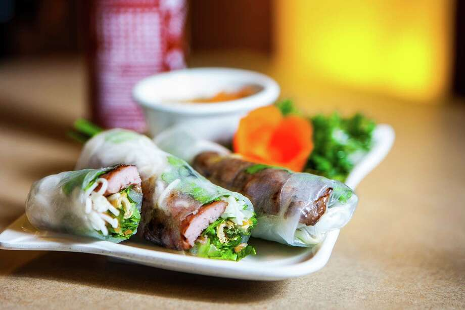 Thanh Phuong Vietnamese & Chinese Cuisine★ - It's game on at Thanh Phuong. 3236 E. Broadway in Pearland, 281-412-7868 Hours: L&D daily, 11 a.m.-10 p.m. Credit cards: all major Prices: starters $2-$8; entrees $6.95-$15.95 Must-orders: Fried sweet rice with BBQ pork; TP special  rolls; deep-fried crispy rabbit with butter sauce; venison carpaccio;  grilled boar in lemongrass sauce Reservations: walk-ins welcome Noise level: quiet to moderate Photo: Nick De La Torre, Staff / © 2013 Houston Chronicle