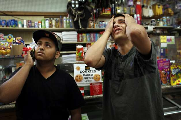 Fernando Aguilera sobs as he and friend Kaid Nasher watch the surveillance video of his brother, Alejandro Aguilera, 18, being shot at the market at 96 Ave. and Olive Street on Saturday, June 2, 2012, in Oakland. Photo: Lacy Atkins, The Chronicle