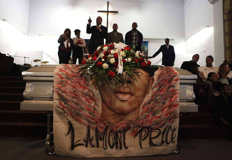 Pastor Harry Fort  stands among the family members of Lamont Price during the funeral for the 17-year-old boy, Wednesday  February 29, 2012, at the Mt. Calvary Missionary Baptist Church in Oakland. Photo: Lacy Atkins, The Chronicle