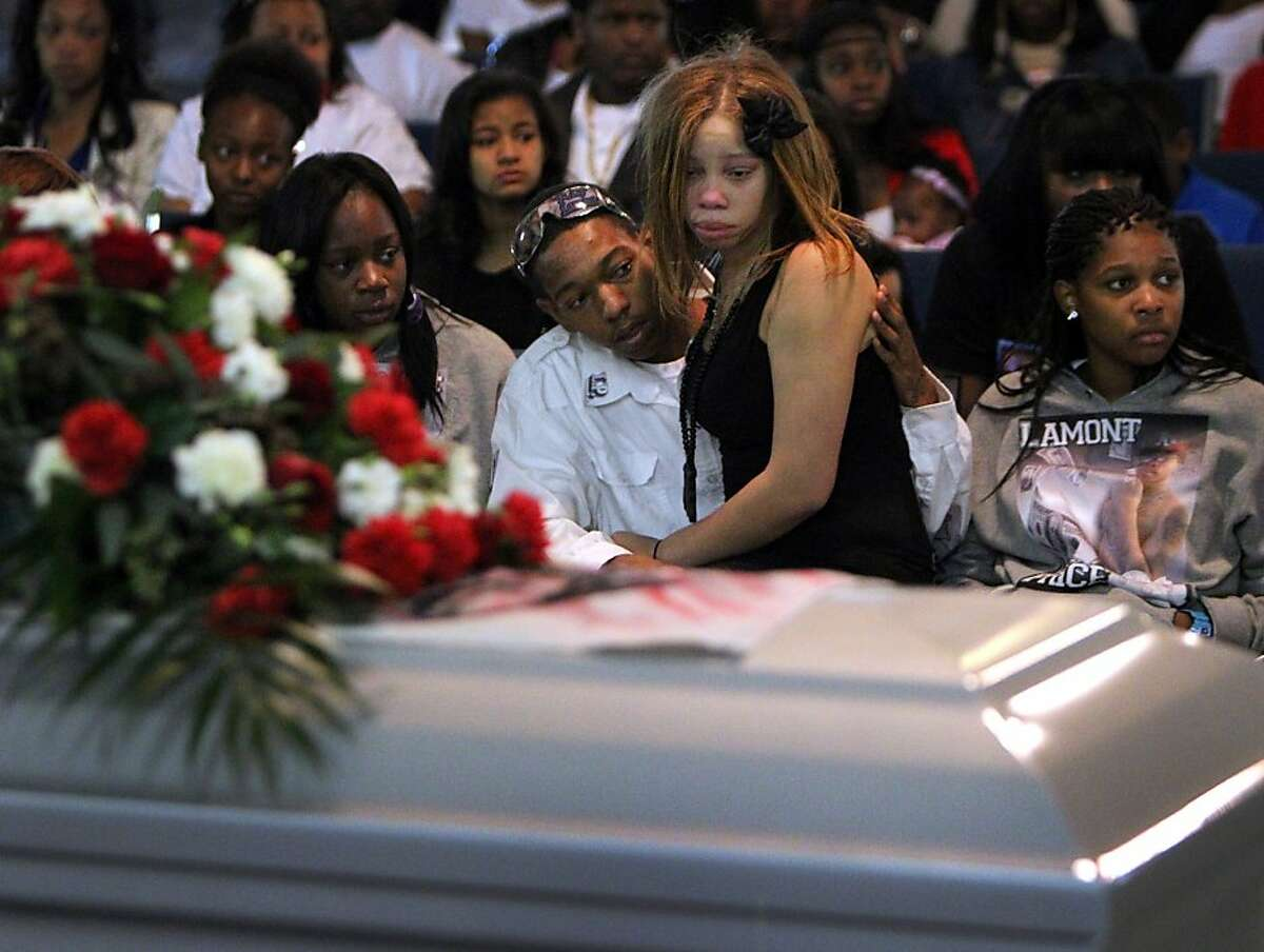 Ramon Price Jr. comforts his sister Brijjanna,16, during the funeral service for their brother Lamont DeShawn Price, 17, Wednesday, February 29, 2012, at Mt. Calvary Missionary Baptist Church in Oakland, Calif. Photo: Lacy Atkins, The Chronicle