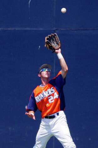 UTSA's Daniel Rockett chases down a fly ball hit by Texas State's Cody Gambill during the fifth inning Sunday May 8, 2011 at Roadrunner Field. Texas State won 7-6. Photo: EDWARD A. ORNELAS, SAN ANTONIO EXPRESS-NEWS / SAN ANTONIO EXPRESS-NEWS (NFS)