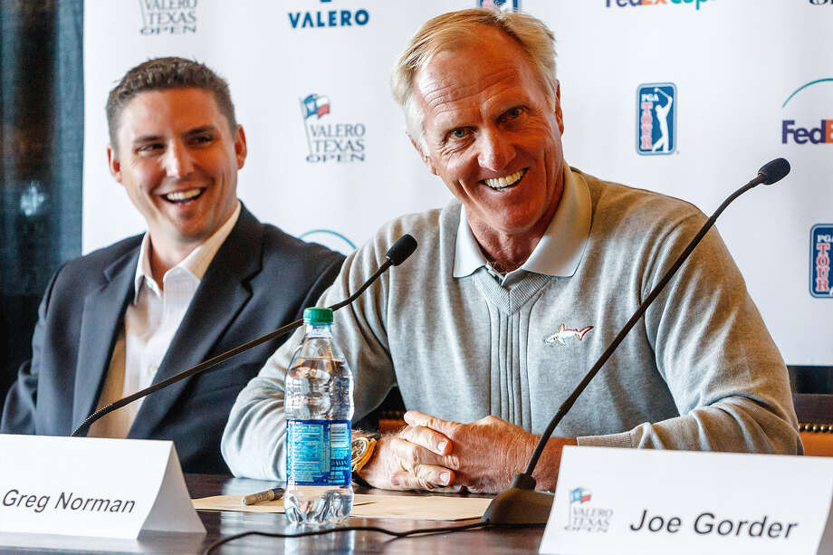 Greg Norman, flanked by Texas Open official Larson Segerdahl, has made a smooth transition to business. Photo: Marvin Pfeiffer / San Antonio Express-News